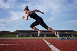 A sprinter trains her body to react automatically to the starter's pistol. How can we train our body to react automatically to help someone in sudden cardiac arrest?